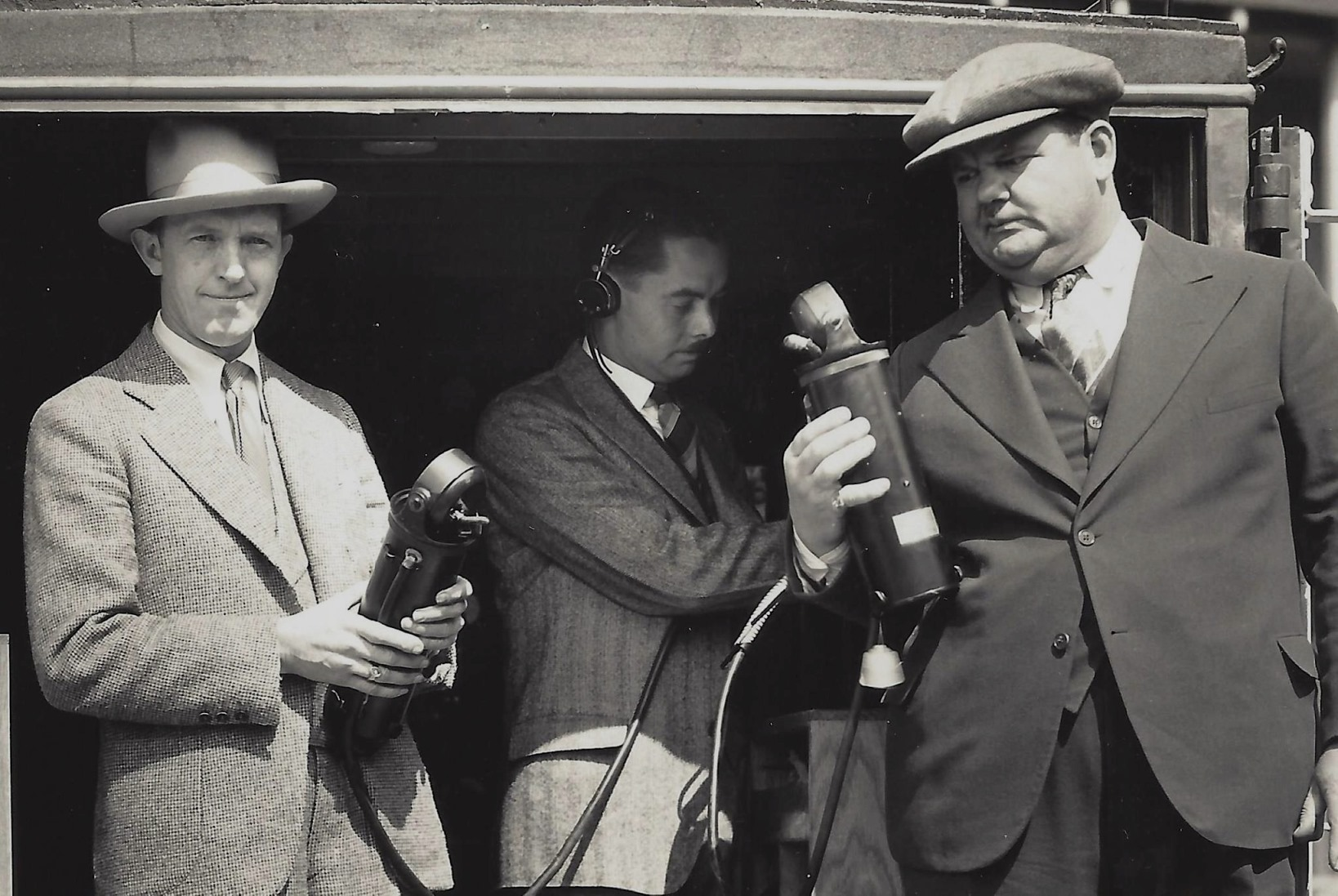 Stan Laurel, Elmer Raguse, Oliver Hardy with microphone equipment